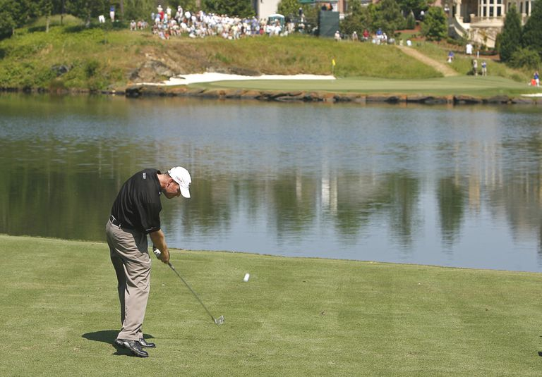 Troy Matteson hits his tee shot over a water hazard on the 11th hole during the third round of the 2007 AT&T Classic