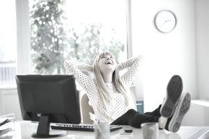Female designer relaxing in office