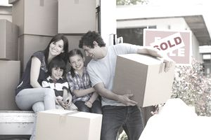 A family with their boxes on a moving van.