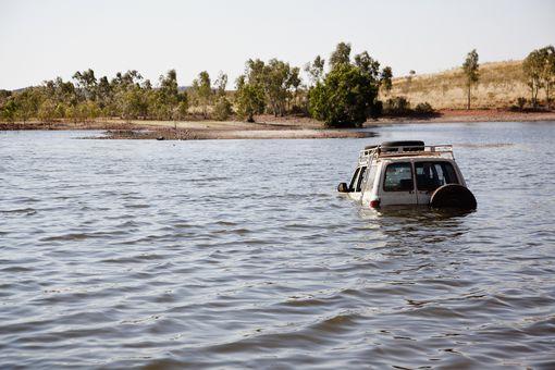 A 4x4 driving through deep water