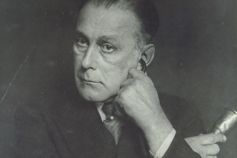 Nearly deaf Austrian Architect Adolf Loos, c. 1929 with listening device, black and white photo
