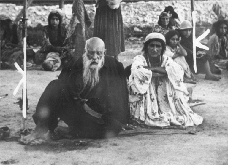 A Gypsy couple sitting in Belzec.