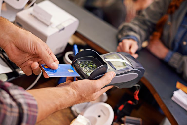 Paying has never been easier Shot of a customer paying for their order with a debit machine in a cafe