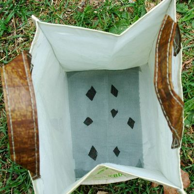 container gardening picture of whole foods bag container garden with holes