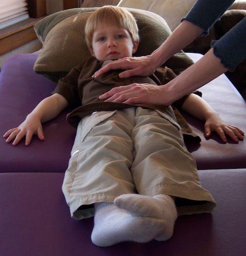 photo of toddler receiving Reiki
