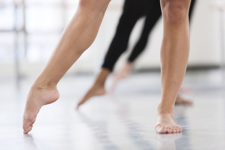 woman pointing toe barefoot