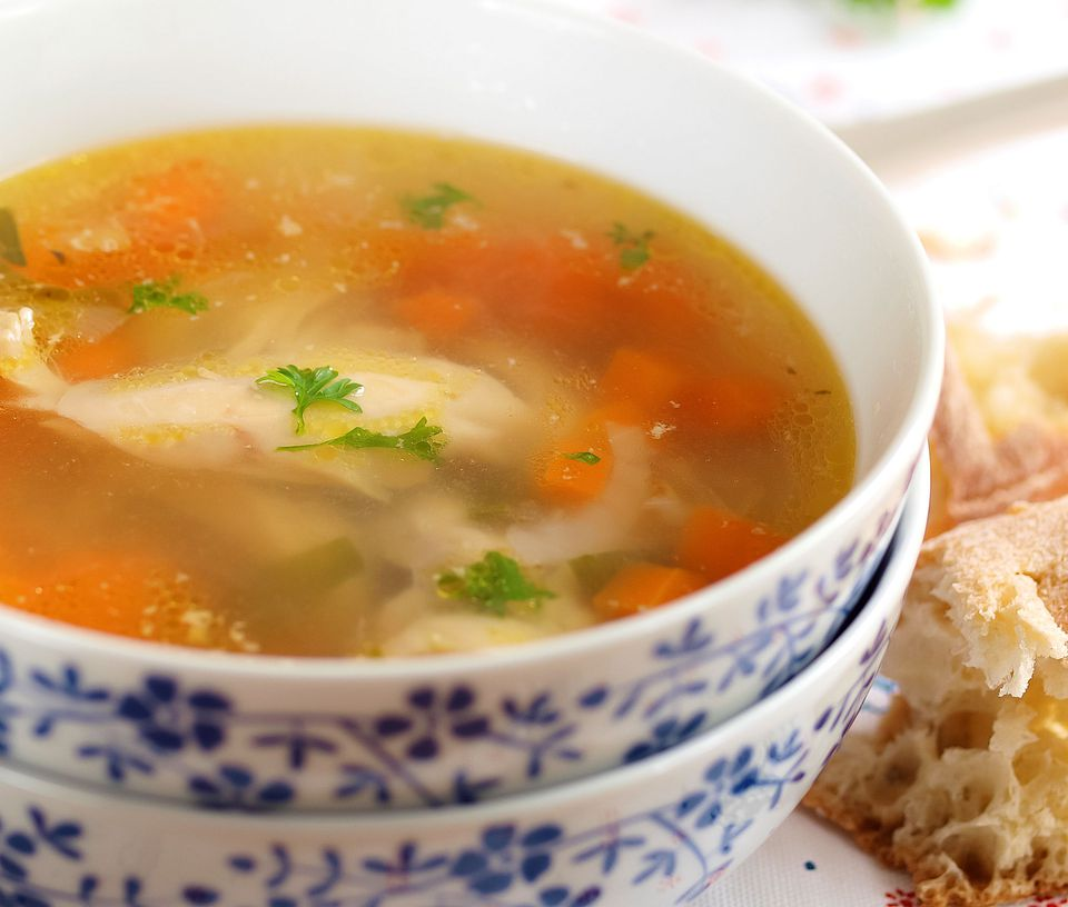 Mexican chicken soup with avocado tomatoes and cilantro for Mexican fish soup recipe