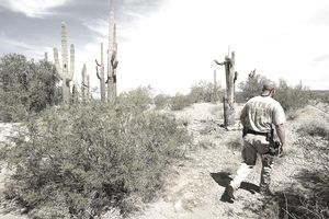 U.S. Forest and Wildlife Service officer patrolling the Sonoran desert area of Arizona