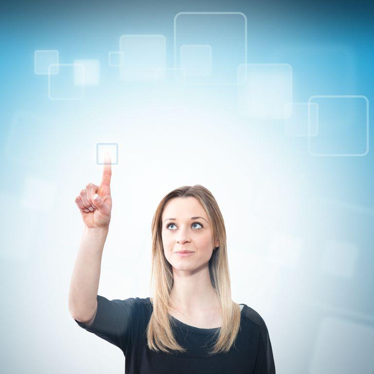 Young woman touching a futuristic screen