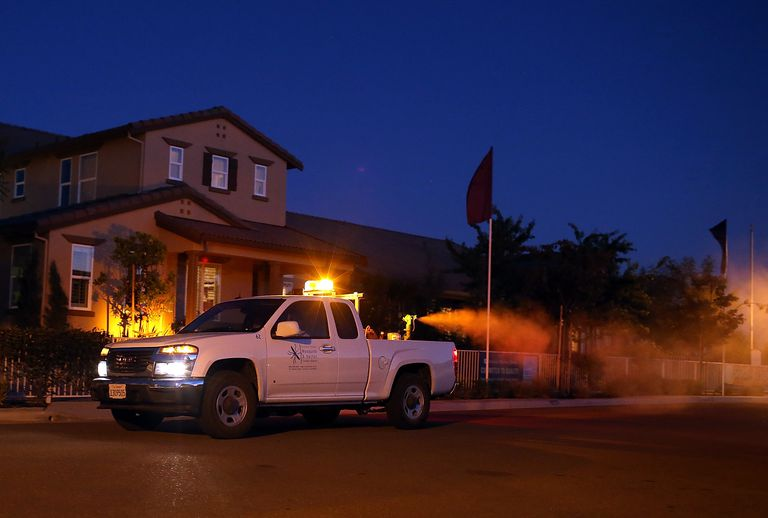 A truck spraying pesticides to control mosquitoes.