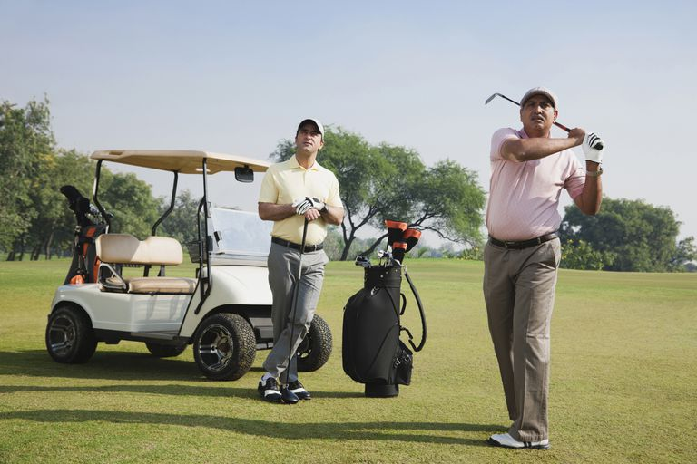Two golfers playing