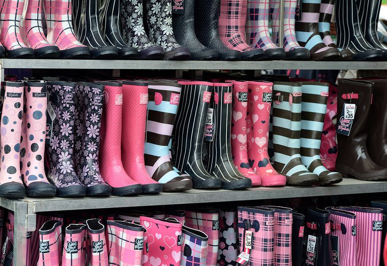 Rows of colorful, patterned and print rain boots at a market.