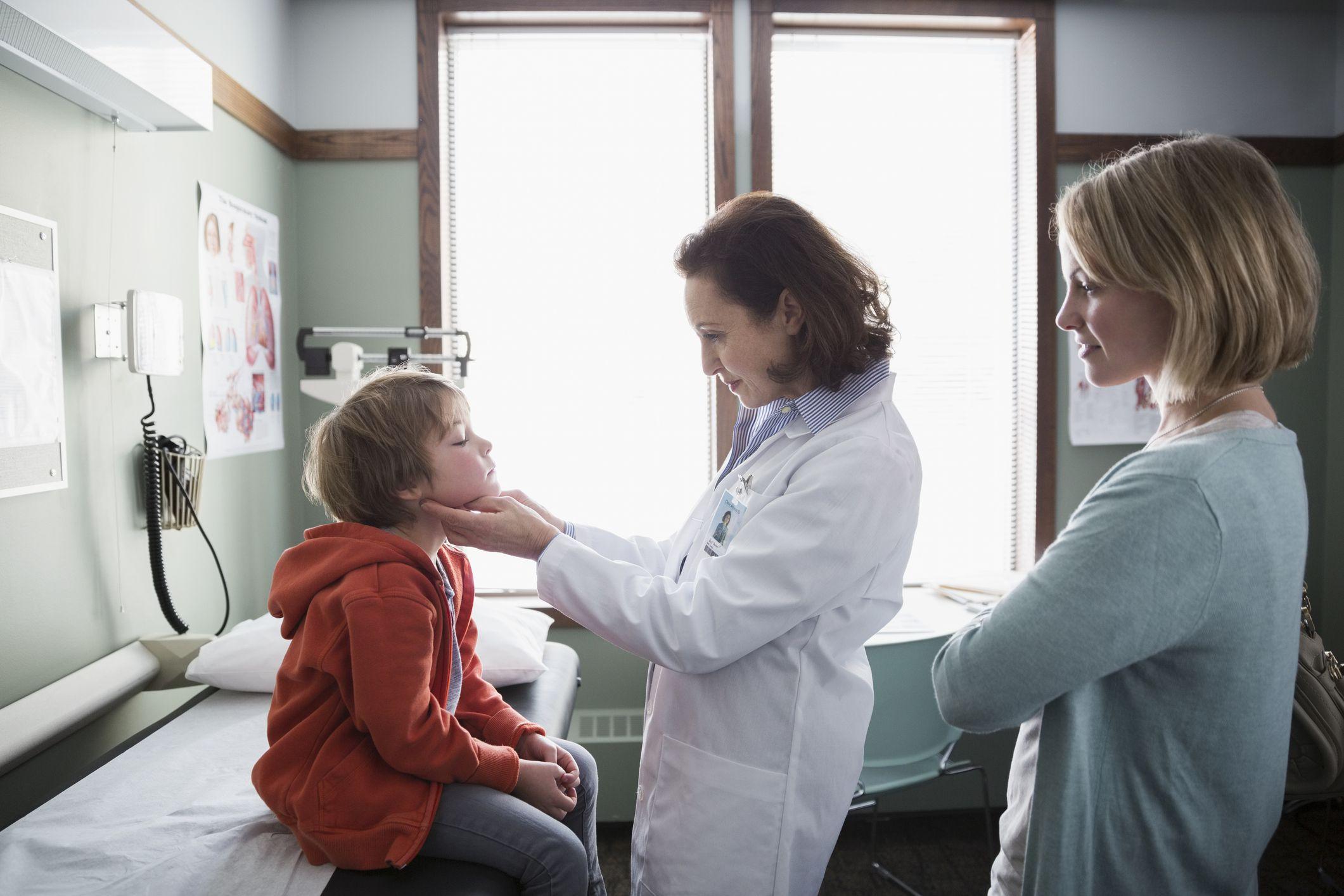 pediatric physician examining child