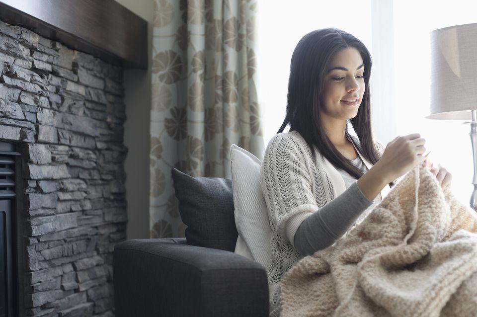 Woman knitting blanket