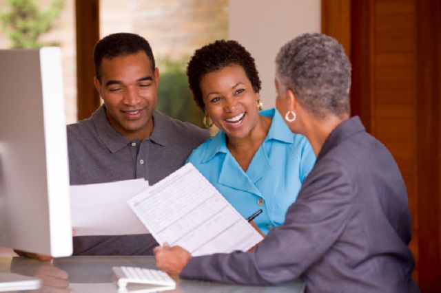 Black businesswoman talking with clients