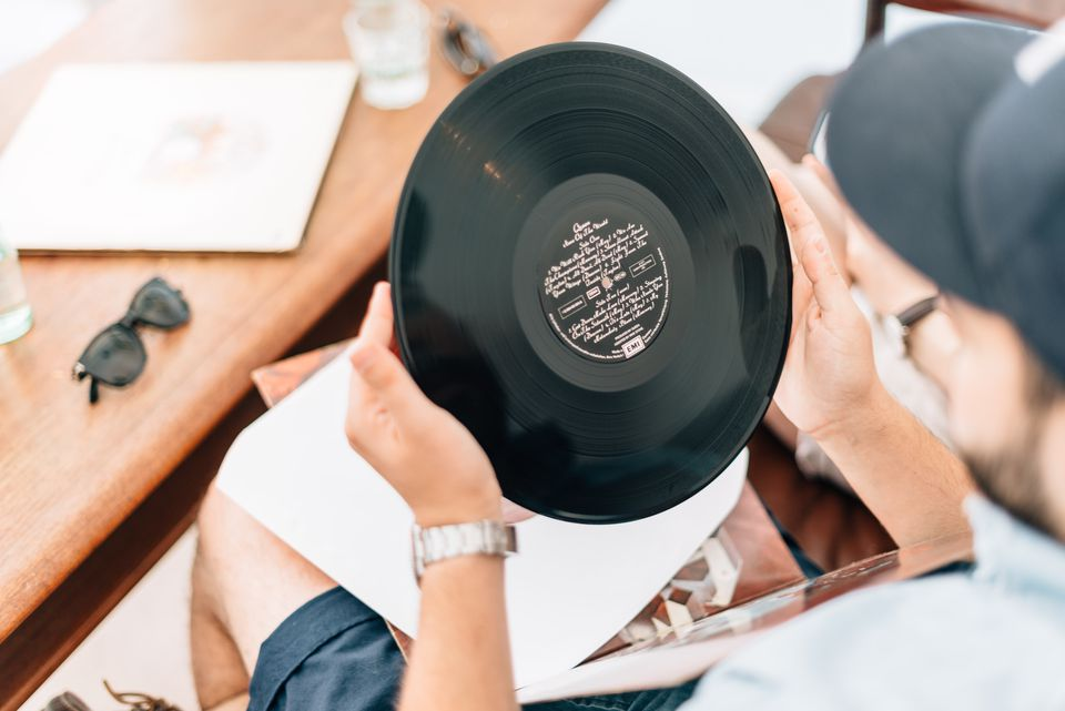 Man holding record album