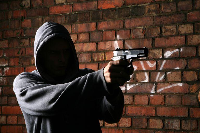 Faceless Gun Toting Hoodlum