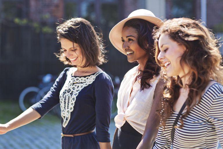Three Stylish Female Friends Walking Together