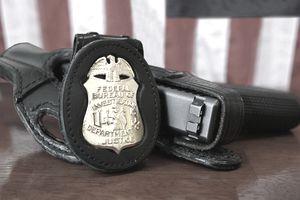 FBI badge and service pistol