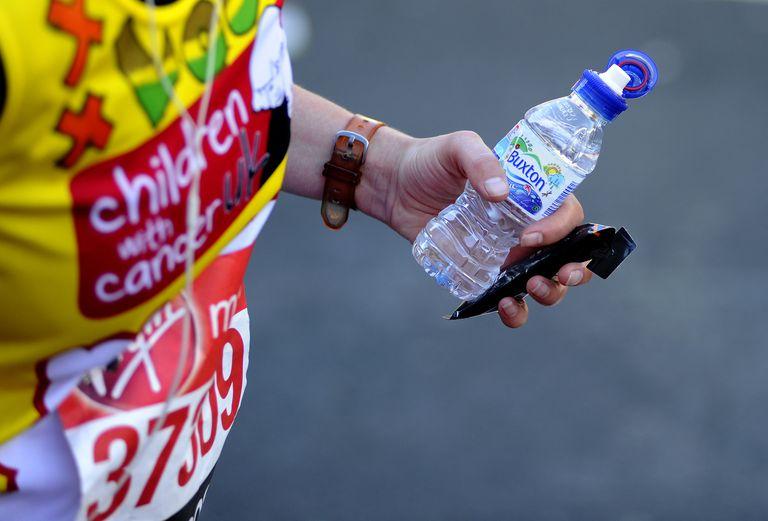 Marathoner with Water Bottle and Energy Gel