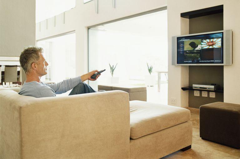 man streaming tv shows at home