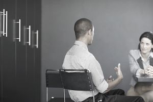 Man talking to a woman in an office