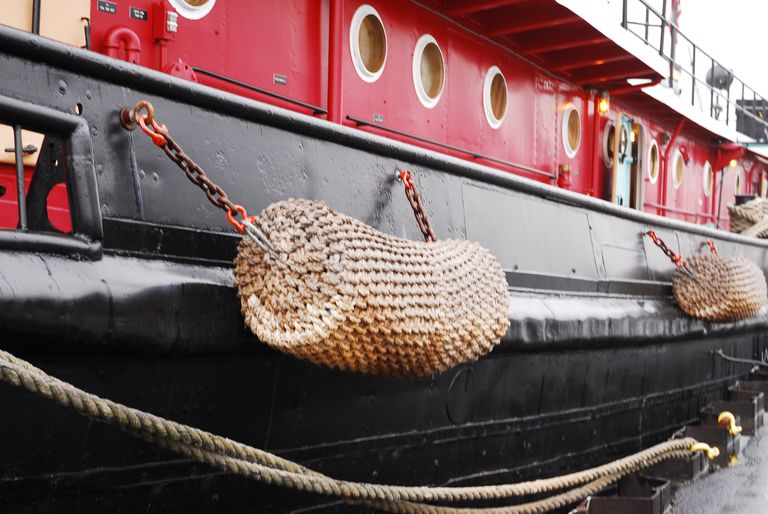 A Close View of a Traditional Cylindrical Layered Rope Knotwork Fender on a Tugboat.