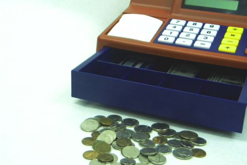 toy cash register and coins