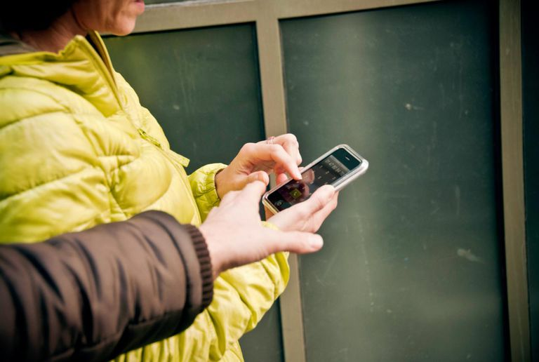 Man stealing woman's smartphone