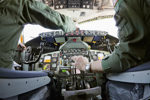 Two pilots working controls in a KC-135.