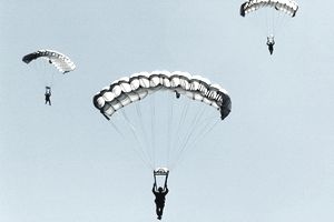 Sailors and airmen parachuting during training exercise