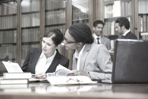 Lawyers talking in a research library.