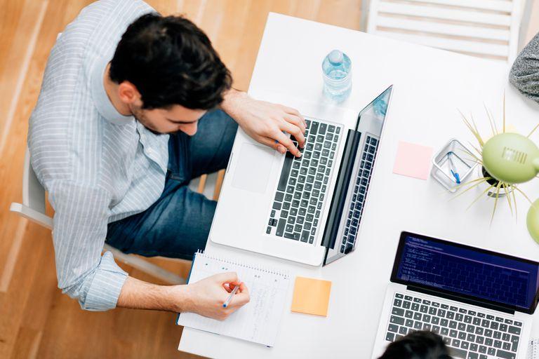 man uses computer to create programs