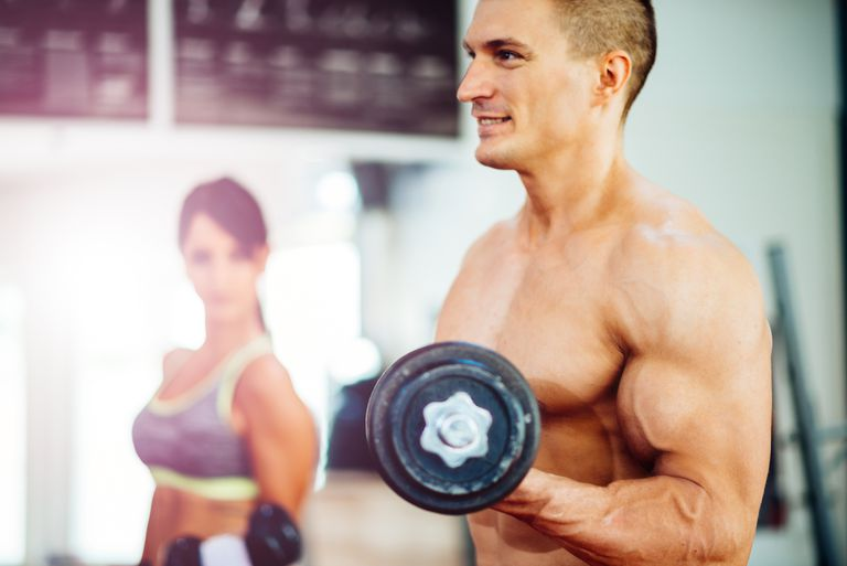 muscular couple lifting weights