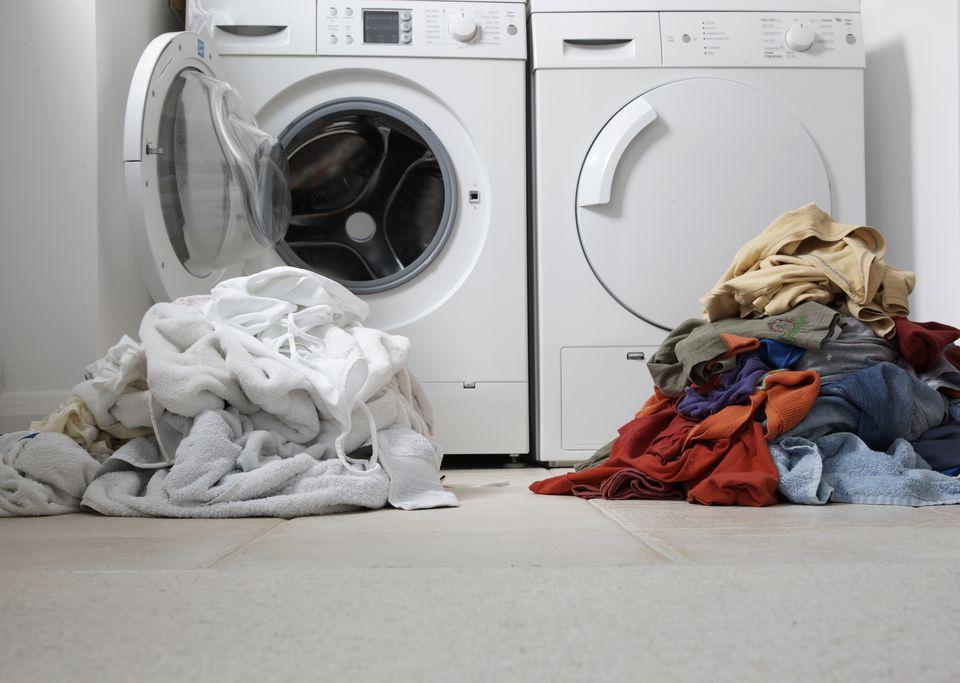 one coloured one white pile of washing