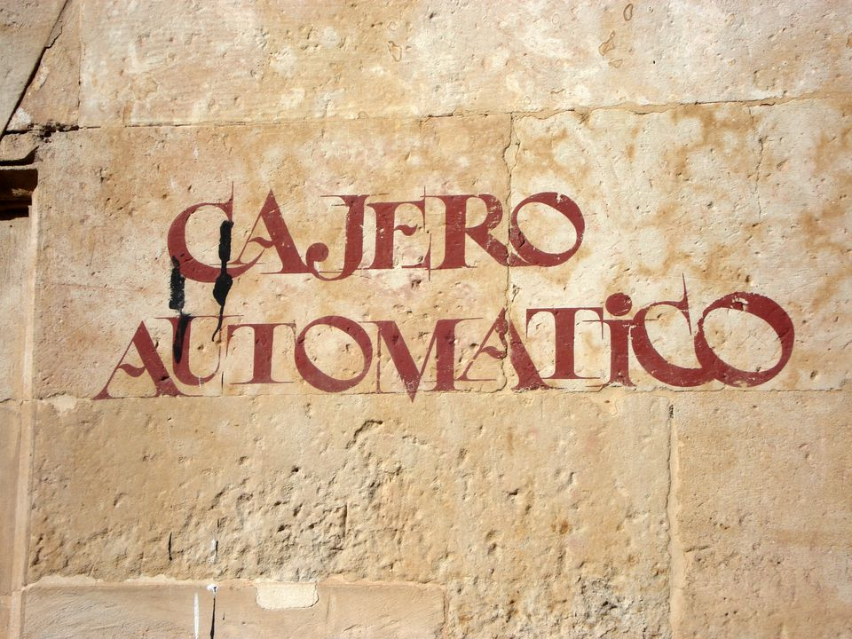 Look out for a Cajero Automatico (ATM) rather than using Travelers Cheques in Spain