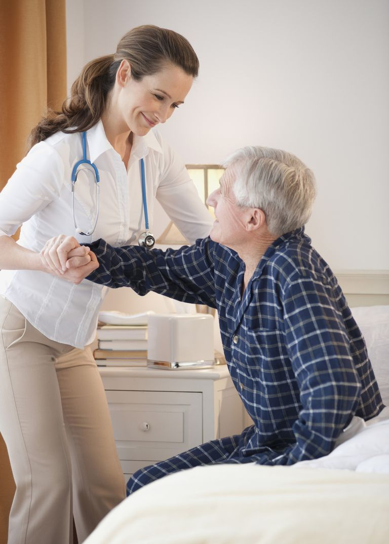 Nurse helping senior man out of man