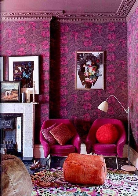 Living room with vibrant purple floral wallpaper