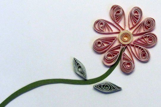 How to Make flowers with rolled paper strips.