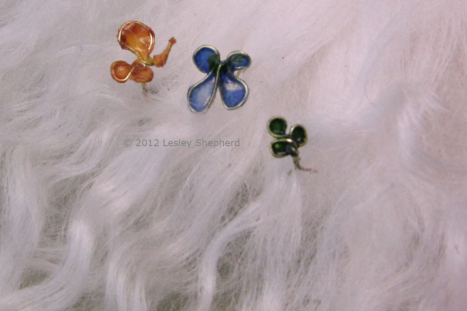 Tiny wire butterfly and shamrock hairpins for dollhouse miniature dolls.