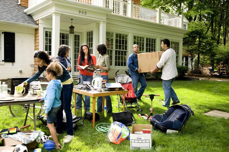 Suburban yard sale, people garage sale shopping