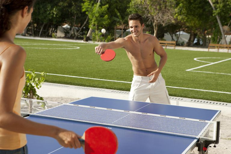 Couple at Island resort spa playing ping pong