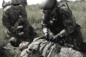 A U.S. Army Special Forces medical sergeant assigned to 1st Battalion, 10th Special Forces Group (Airborne) observes a members of the Slovak Republic 5th Special Forces Regiment conduct first aid on a simulated casualty as part of a Partnership Development Program event at the Military Training Center Lest in Slovakia.