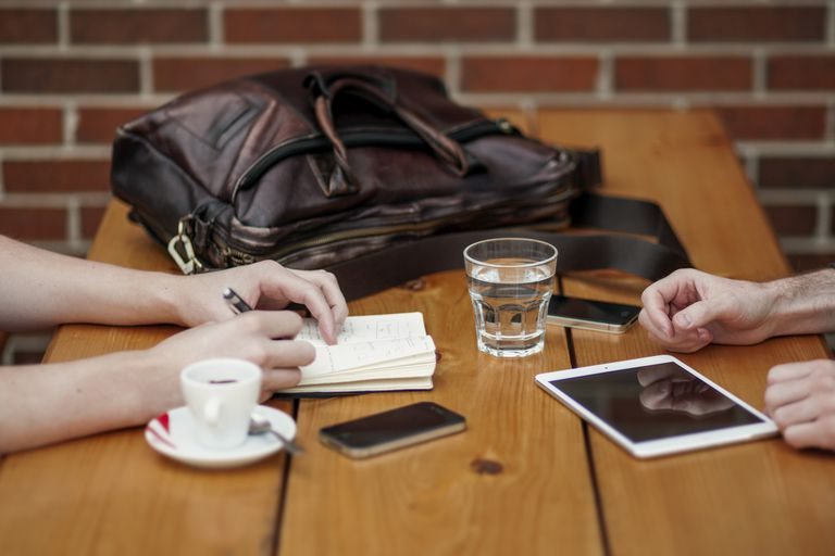 Business meeting with iPhone and iPad