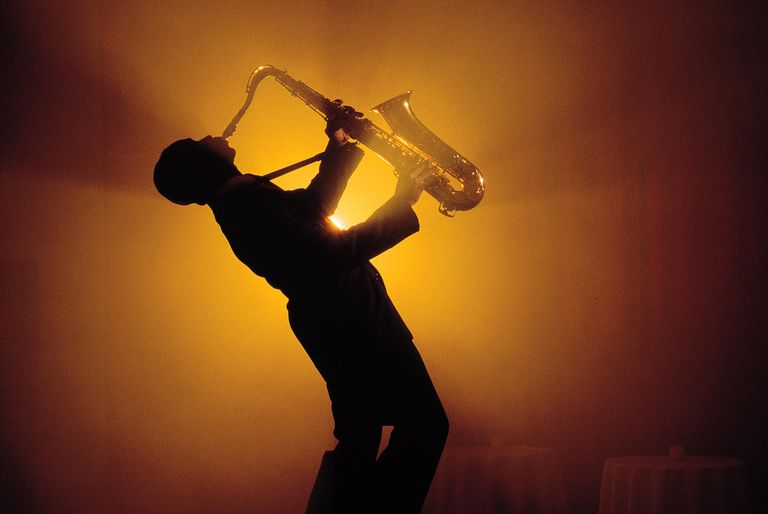 Silhouette of man playing saxophone