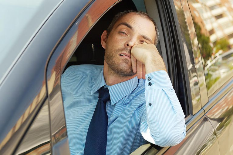 A man in a car hating his commute symbolizes ritualism in sociology--going through the motions of daily life even though you don't believe they are worth it.