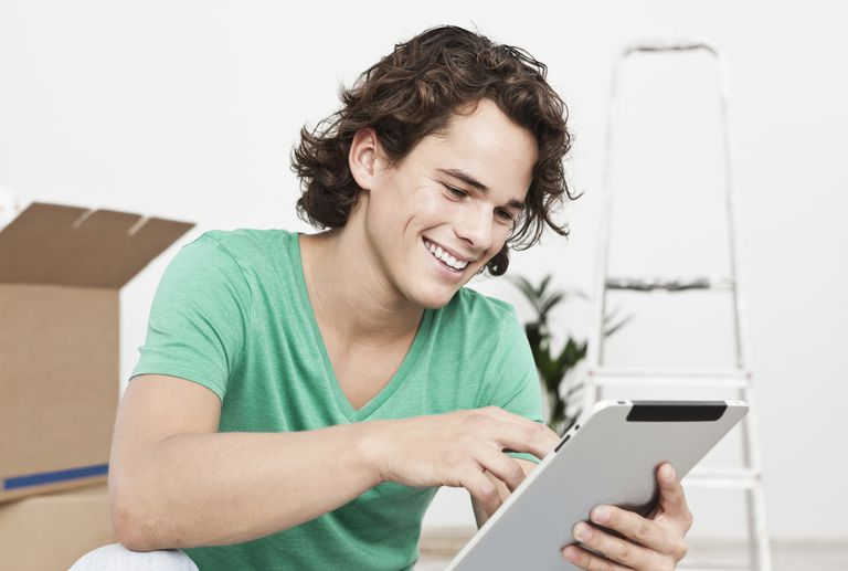 Young man using digital tablet in home
