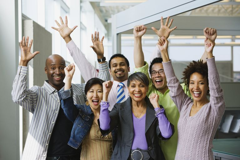 Multi-ethnic business people celebrating the fruits of their commitment in office