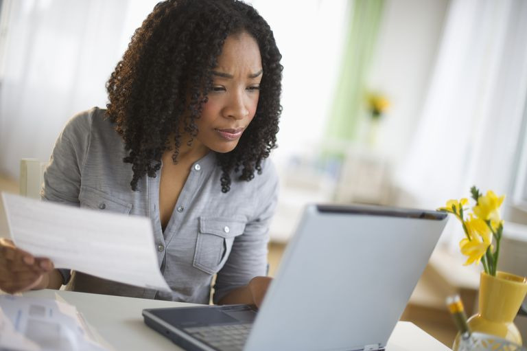Woman checking credit card account online