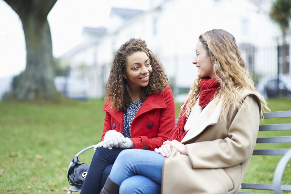 Friends chatting on a park bench